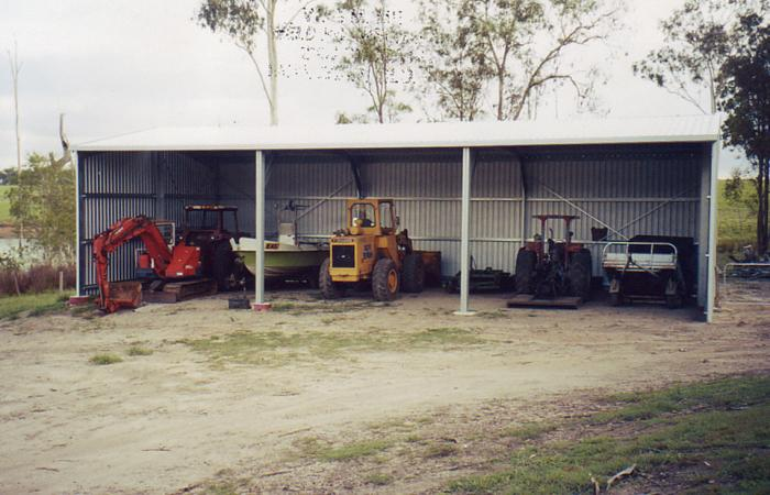 Protect your farm assets with a steel implement shed for Open front shed