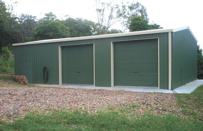 Double Garage with More space for storage Green cladding with smooth Cream trim